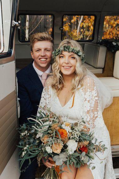 Boho Bride and Groom Sitting in a Camper Van Wedding Car