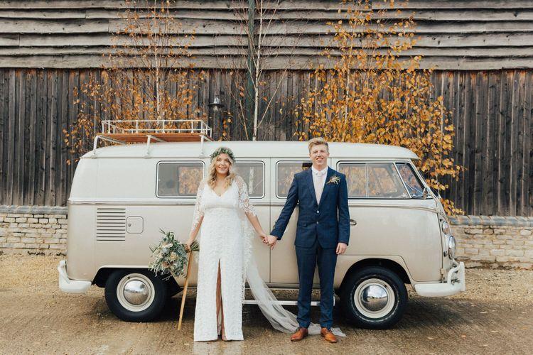 Boho Bride and Groom Standing in Front of Their Camper Van Wedding Car