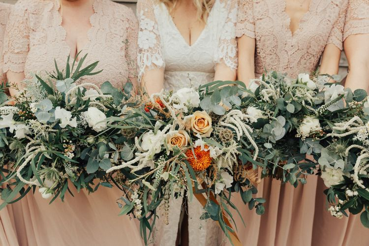 Bridal Party Bouquets with White and Orange Flowers and Foliage