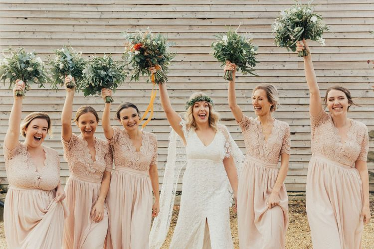 Bride in Grace Loves Lace Wedding Dress and Bridesmaids in Pink Lace ASOS Dresses