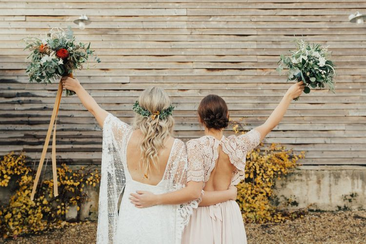 Boho Bride in Grace Loves Lace Wedding Dress and Bridesmaid in Backless Pink Lace ASOS Dress
