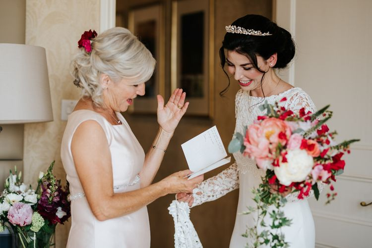 Mother of the bride reads emotional letter that bride wrote for her and tries to keep herself from crying