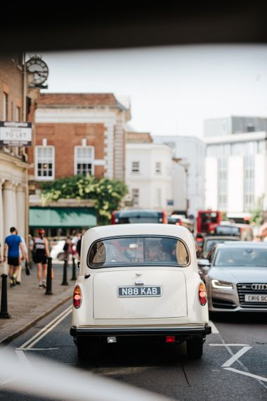 Bridal car driving through Richmond towards Kew Gardens wedding