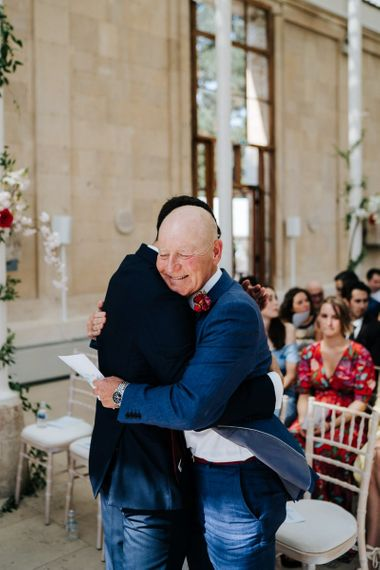 Groom greets guests at Kew Gardens wedding ceremony