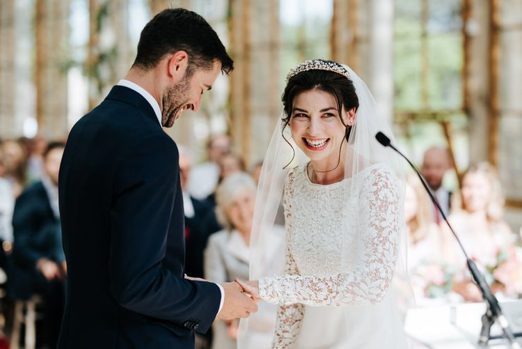 Groom puts ring on bride at Kew Gardens wedding