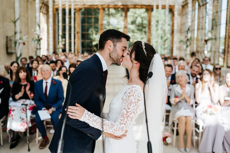 First kiss at nash conservatory wedding at Kew Gardens wedding.