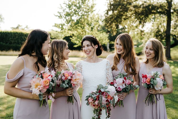 Pink bridesmaid dresses with pink flower bouquets