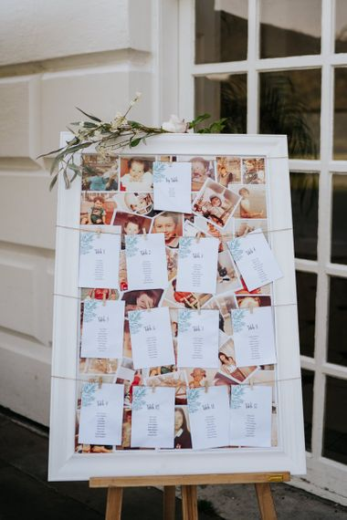 Wedding table seating chart with couple photographs behind