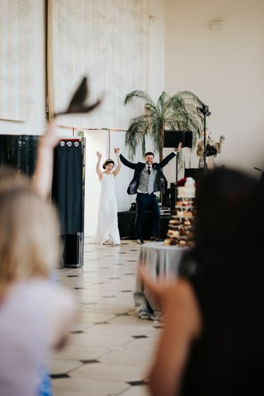 Bride and groom make their epic entrance at wedding breakfast