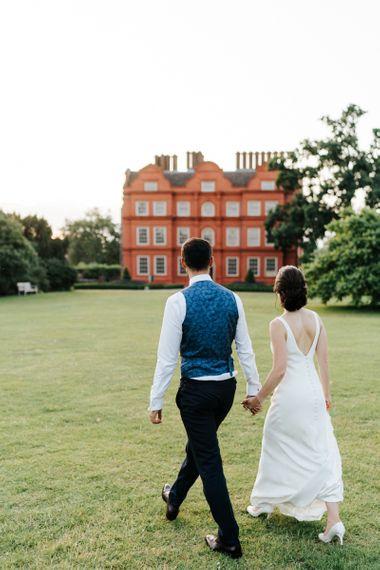 Bride and groom go for a stroll around Kew Gardens wedding venue