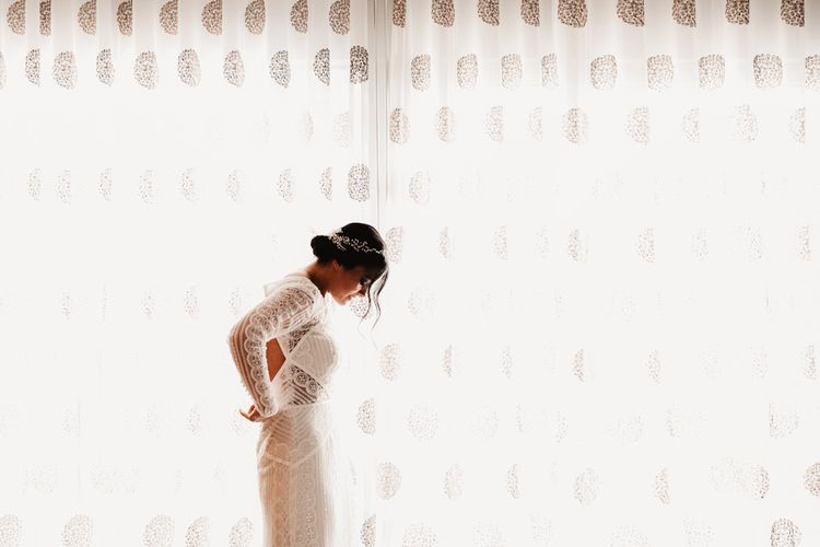 Bride in Lenora Dress by Wtoo Watters with Lace Sleeves and Keyhole Back | Prudence Halo Headpiece by Kelly Spence Wed | String Lights, Perspex Table Signs and Paper Cranes for Industrial Wedding | Frankee Victoria Photography