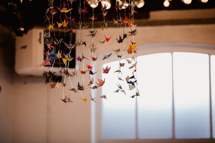 Hanging Paper Cranes | Trinity Buoy Wharf Wedding Venue | String Lights, Perspex Table Signs and Paper Cranes for Industrial Wedding | Frankee Victoria Photography