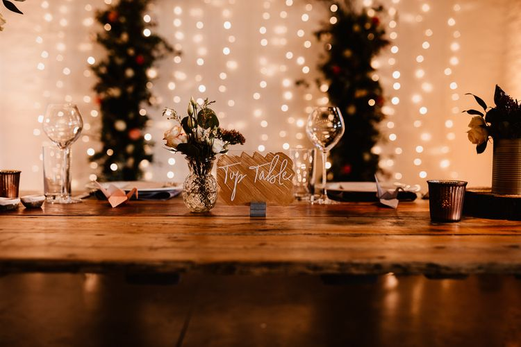 Copper and Perspex Table Sign | Wooden Top Table | Festoon Lights | Flowers and Foliage in Bud Vase | Paper Crane Place Settings | Copper Tea Light Candle Holders | Trinity Buoy Wharf Wedding Venue | String Lights, Perspex Table Signs and Paper Cranes for Industrial Wedding | Frankee Victoria Photography