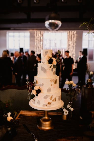 Four-Tier Wedding Cake with Painted Buttercream and Fragmented Edible Gold Leaf | String Lights, Perspex Table Signs and Paper Cranes for Industrial Wedding | Frankee Victoria Photography