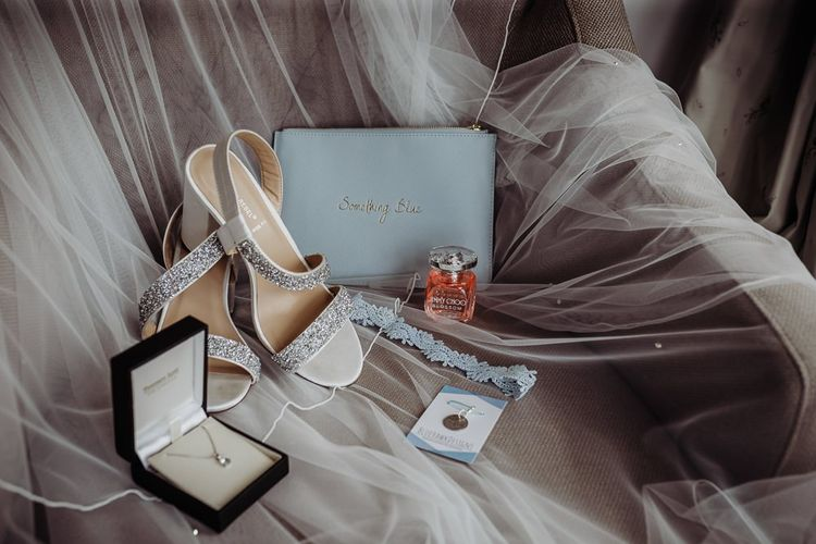 Bridal accessories and a 'something blue' bag at rustic barn wedding in The Cotswolds