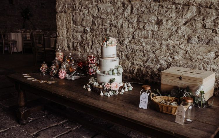 Pic and mix sweet station and semi naked wedding cake at Cogges Manor Farm wedding