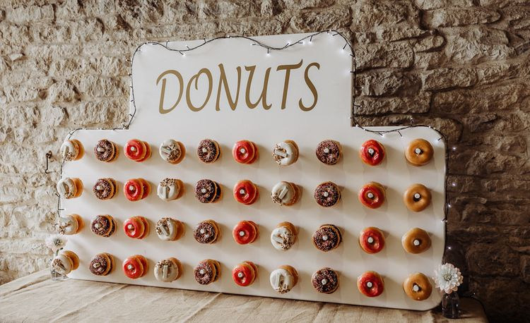 Rustic styled donut wall at Cogges Manor Farm wedding