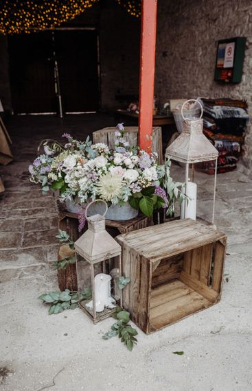 Candle lanterns and pastel floral arrangements at Cogges Manor Farm wedding