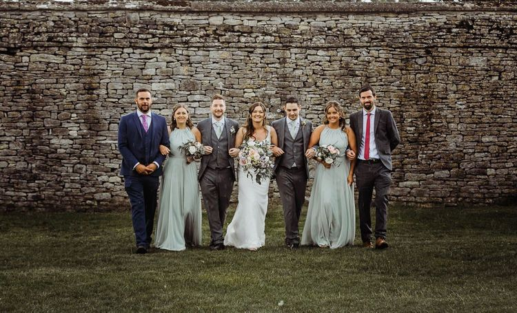 Bride and groom with their wedding party at Cogges Manor Farm