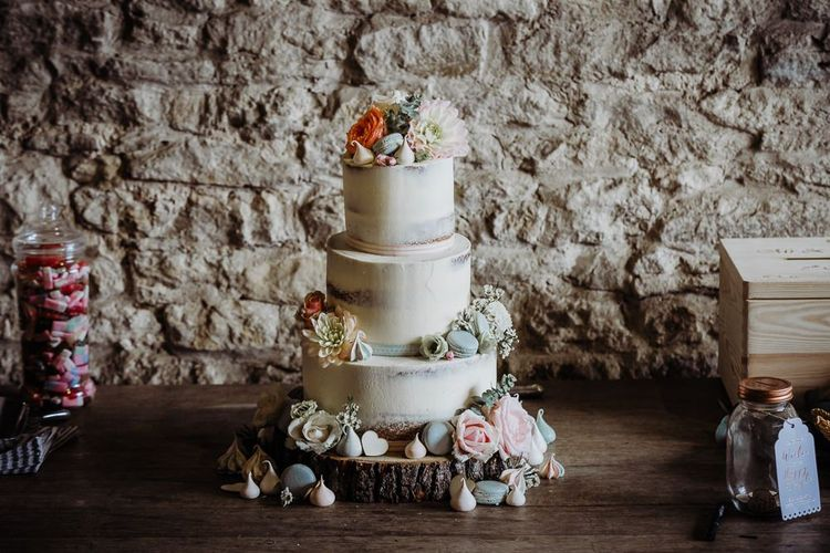 Rustic styled wedding with semi naked cake decorated with pastel florals