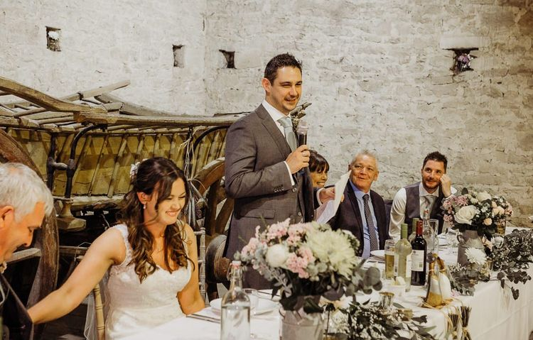 The grooms speech at Cogges Manor Farm wedding reception with rustic styling