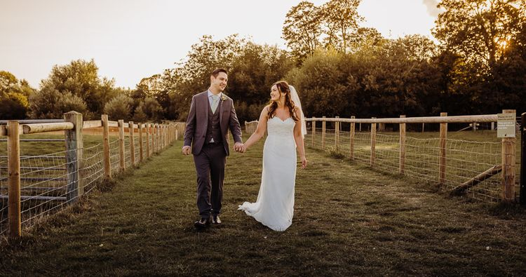 Bride and groom steal a moment to enjoy the views at their Cogges Manor Farm wedding
