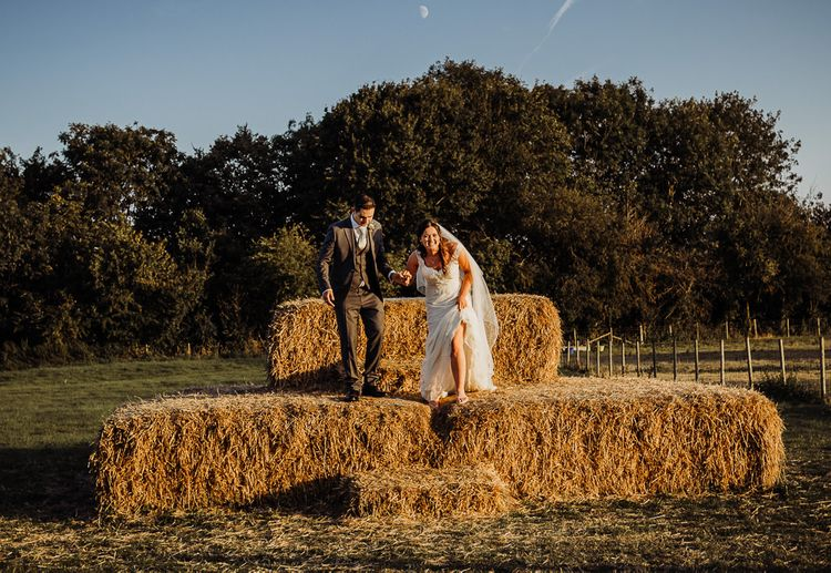 Making the most of their farm wedding the couple pose for some shots