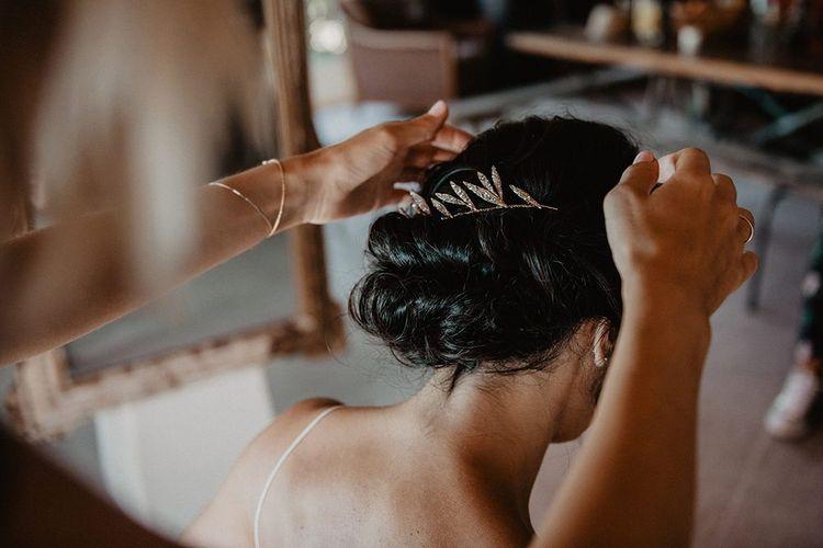 Bridal undo with leafy hair piece
