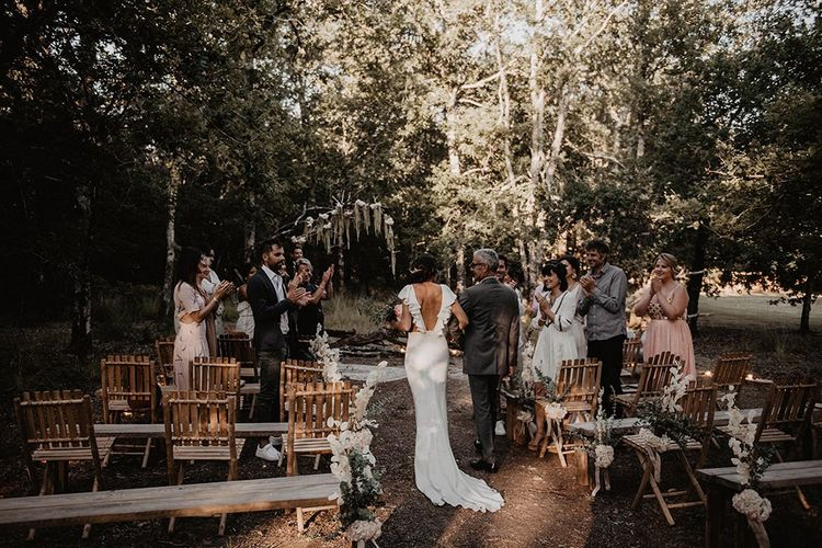 Ruffle wedding dress at outdoor wedding ceremony