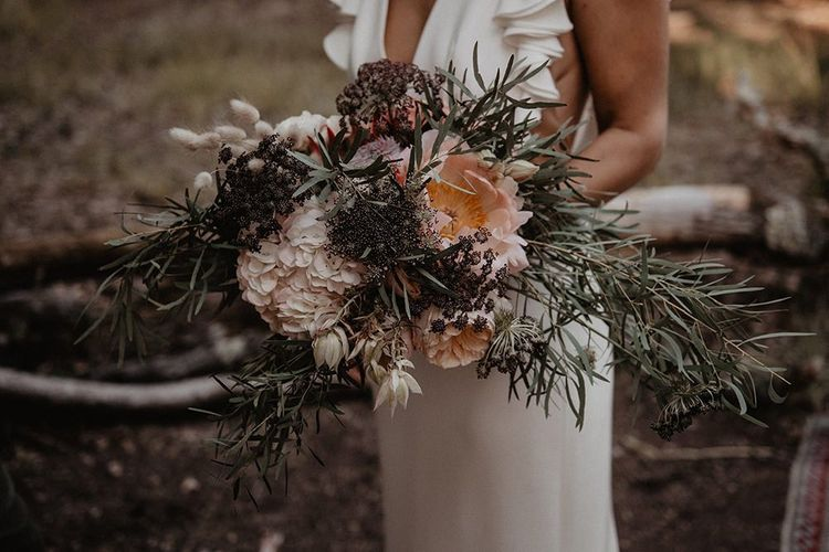 Large wedding bouquet with foliage and pink flowers
