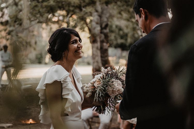 Bride and groom exchange vows in outdoor intimate wedding ceremony