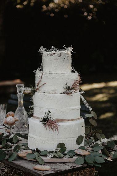 Large white wedding cake at destination wedding