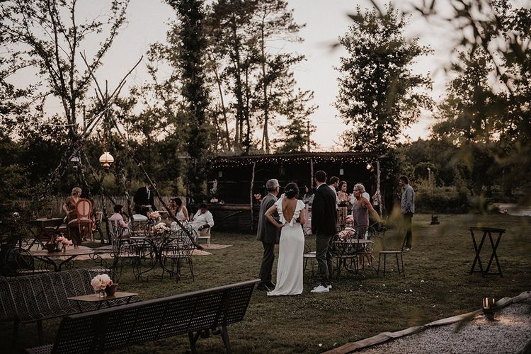 Bride and groom enjoy their day with their closest friends and family at small wedding