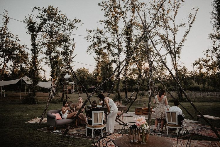 Naked tipi seating area at intimate wedding