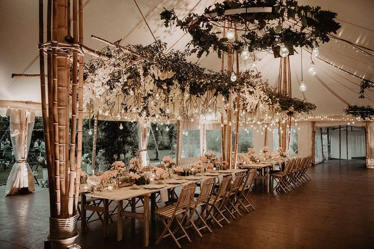 Amazing hanging light installation for intimate wedding dinner