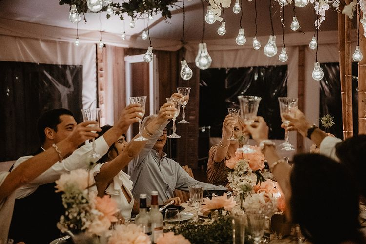 Guests toast the day at intimate wedding