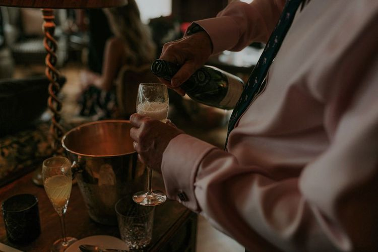 Guests Pour Champagne Before Church Ceremony
