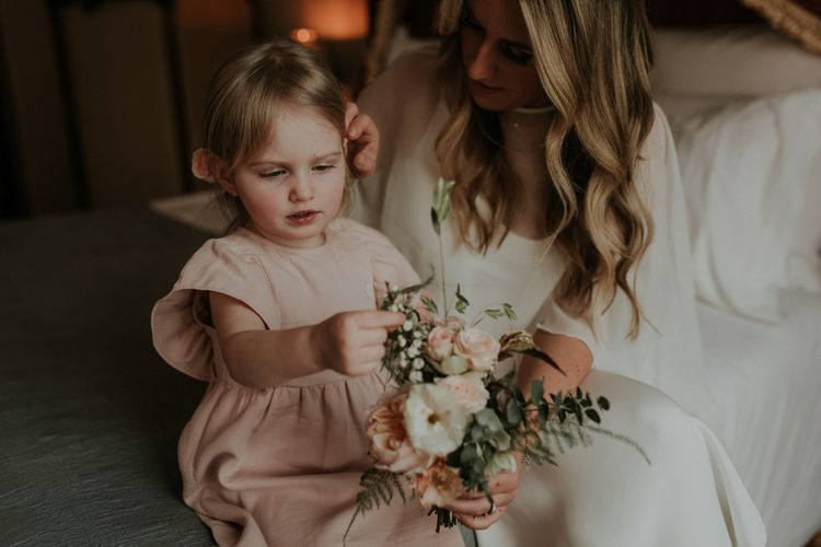 Bride In Wedding Cape Takes A Moment With Daughter Before Ceremony