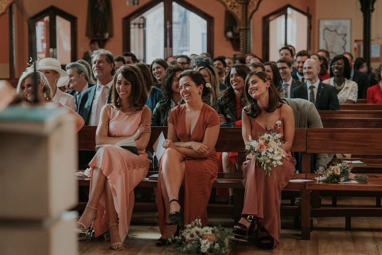 Bridesmaids In Mismatched Dresses During Ceremony