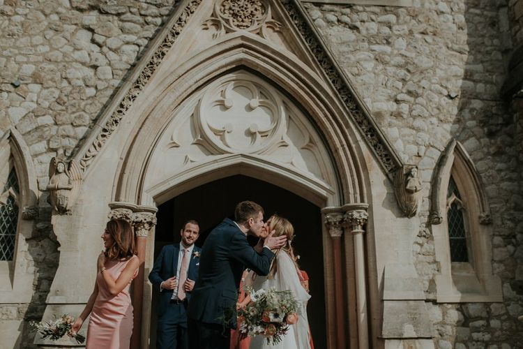 Bride And Groom Kiss Outside Church Ceremony Venue