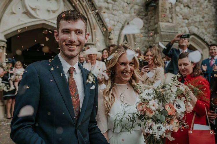 Bride In Wedding Cape and Groom Confetti Exit
