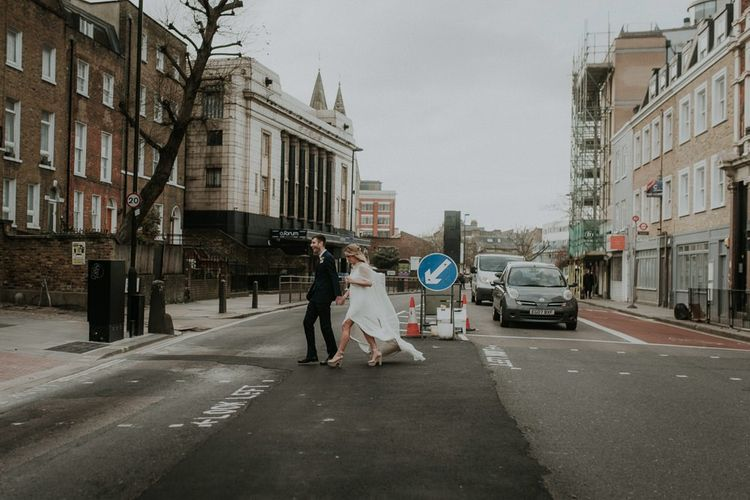Bride and Groom Cross The Busy Roads For London Wedding