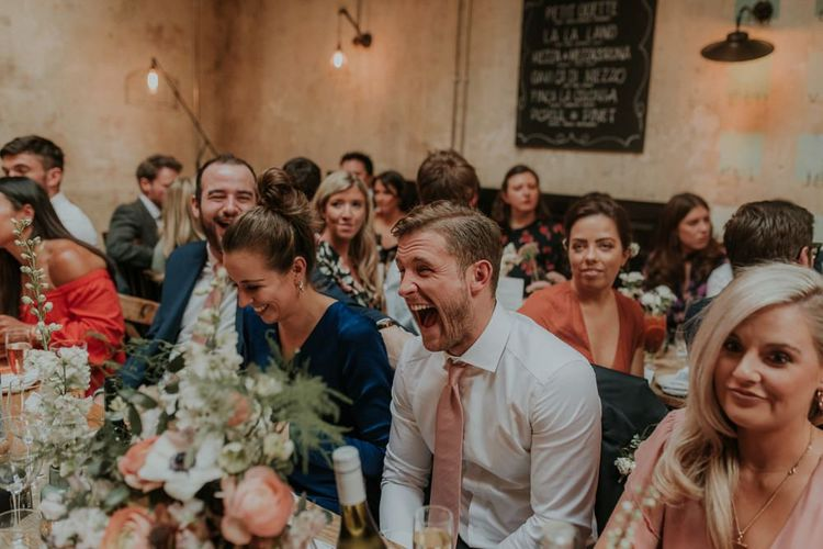 Guests Enjoy Speeches During Wedding Reception