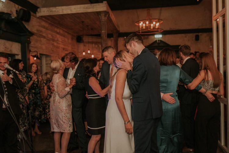 Bride and Groom Enjoy Dance
