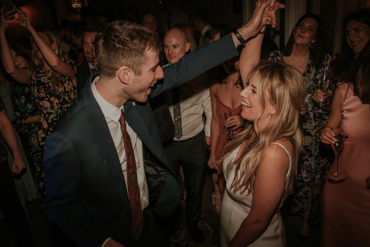 Bride and Groom Dance The Evening Away With Guests