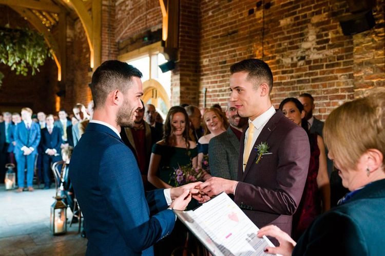 Two Grooms in Burgundy and Navy Remus Uomo Suits