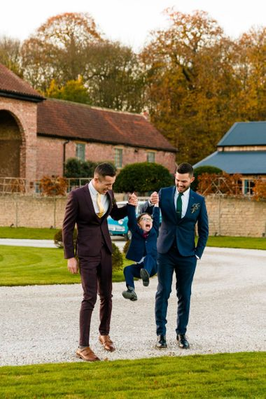 Grooms in Burgundy and Navy Remus Uomo Suits with Page Boy