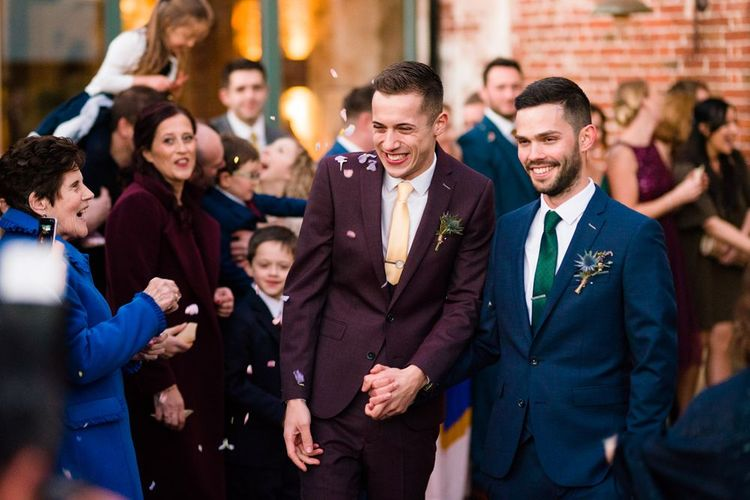 Confetti Moment with Grooms in Burgundy and Navy Remus Uomo Suits