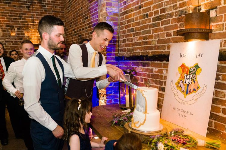 Two Grooms Cutting Harry Potter Wedding Cake