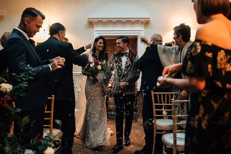 Confetti Moment with Bride in Embellished Wedding Dress and Groom in Velvet Dinner Jacket
